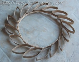 Toilet Paper Roll Craft - Toilet Paper Roll Wreath - Frugal Craft Projects - Toilet Paper Wall Art! This wreath is so beautiful - never would have thought it was made from toilet paper rolls! happydealhappyday.com