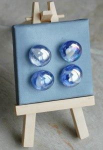 blue glitter magnet with white marble