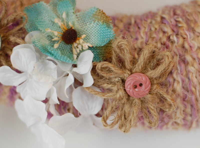 DIY Yarn Wreath with Twine Flowers: here is an easy tutorial showing you how to make a yarn wreath, and decorate it with some cute twine flowers and other fake or burlap flowers! happydealhappyday.com