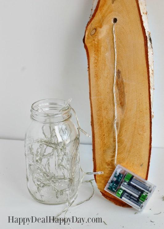 How To Make A Mason Jar Wall Sconce put lights in mason jar