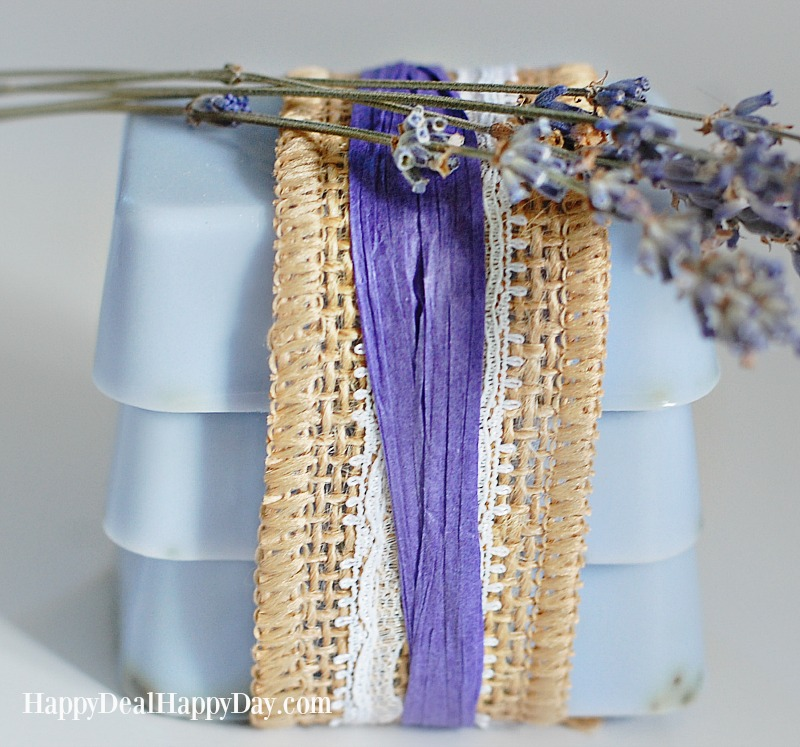 homemade lavender Soaps beautifully wrapped in ribbon with sprig of lavender