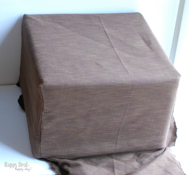 How To Reupholster an Ottoman- new cover on old ottoman