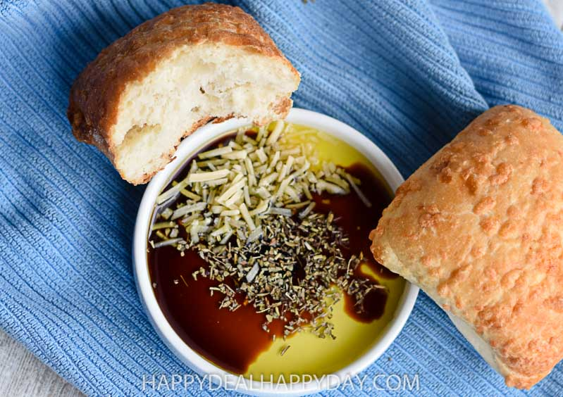 olive oil bread dip with parmesan cheese birds eye view