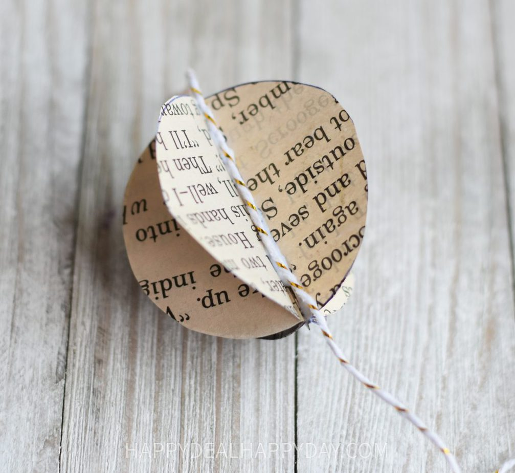 add twine to hang a thrift store book Christmas Ornament.