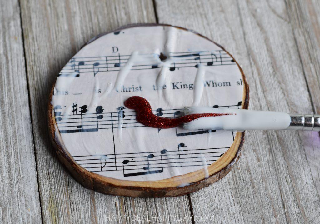 add glitter glue to thrift store book wood slab diy Christmas ornament