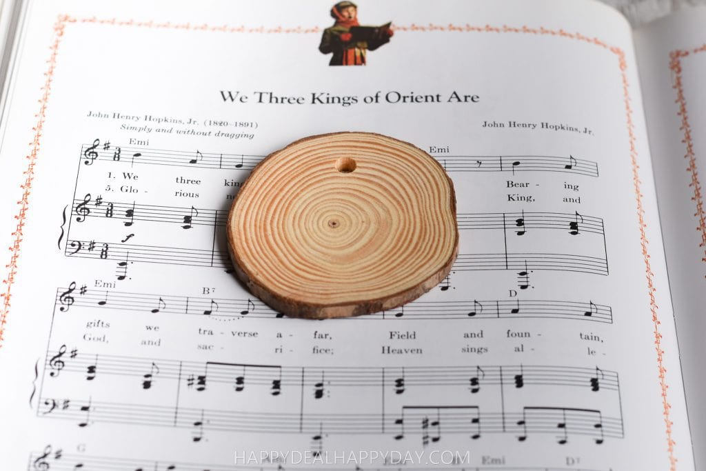 Trace music from a thrift store book for wood slab Christmas ornament