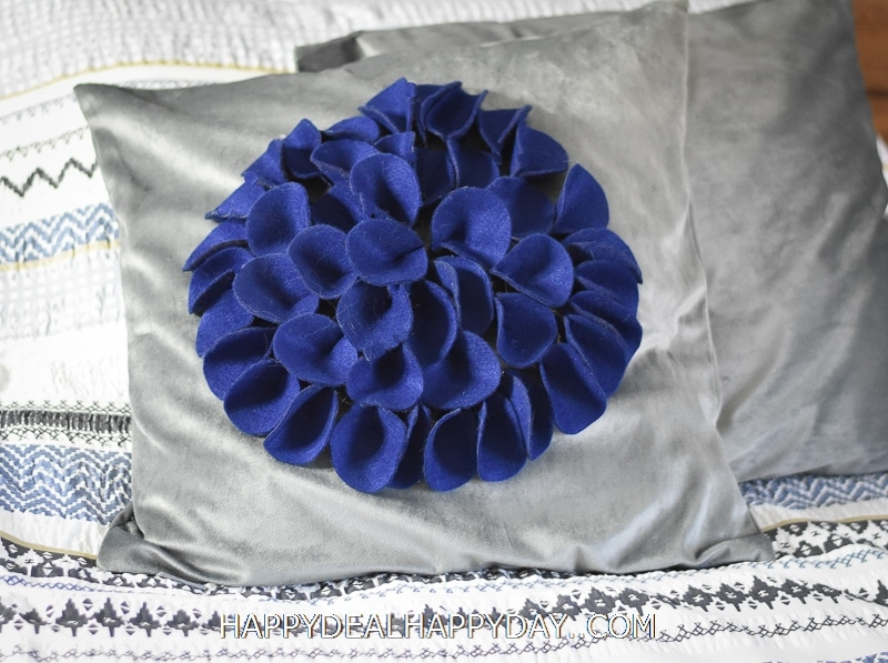 throw pillow with felt flower on top