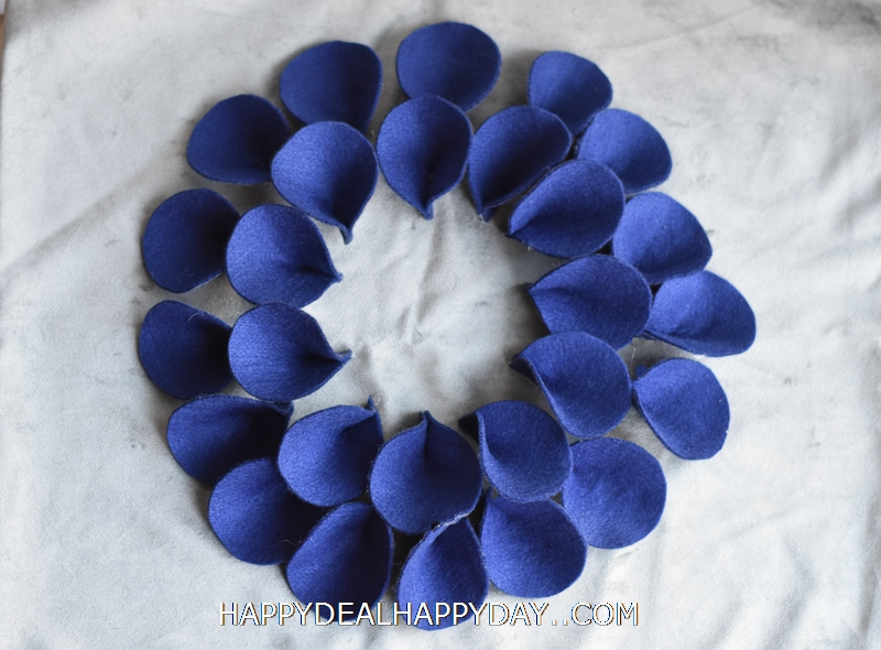 felt flower half glued on a pillow case