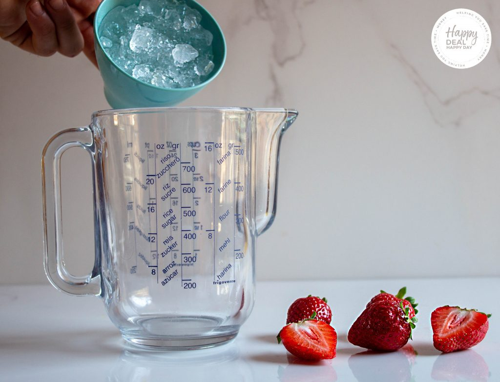 pouring ice for strawberry slushie